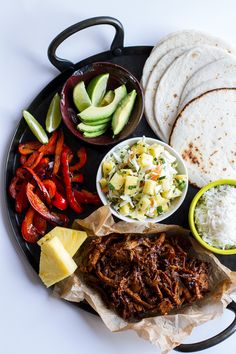 Hawaiian Hula Pork Fajitas with Pineapple Slaw + Coconut Rice. You could also substitute beef for the ports or chicken.