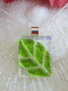 This beautiful dichroic glass Leaf Pendant has the base of silver dichroic glass topped with clear glass to make it glossy and shiny and to give