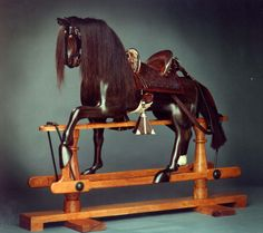Native Texan Artist, Alan Carr, sculpts these gorgeous wooden rocking horses FOR ADULTS!  Did I mention that it will be the first thing I buy after I win a lottery?