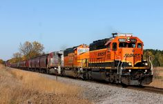 https://flic.kr/p/ZKGuGb | BNSF 1692 | H-SUPNTW1-18A approaches Isanti in some sweet afternoon light. This unit was on my list for quite a while. When I last saw this unit, it didn't have the A/C units on top, nor PTC. It almost looks like an RCO unit. Well Mike, I hope this answered your questions about this unit.  BNSF 1692 BNSF 1463 BNSF 649