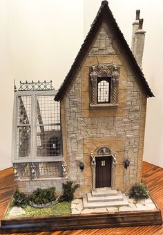 Rik Pierce medieval hunting lodge - I love the mix of materials on the front of the house...