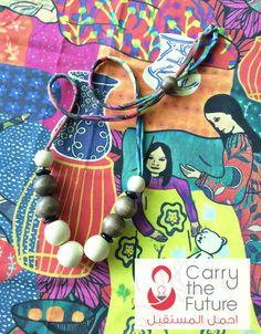 The Carry the Future Necklace is a project so dear to my heart. Carry The Future is one of my favorite organizations. Started just last year, Carry the Future collects used baby carriers and delivers them to mothers and fathers running from conflict. Carry the Future hand-delivers baby carriers and infant supplies to families in refugee camps overseas. As a grassroots organization, every donation makes a huge impact.I designed this necklace with mothers in mind. The fabric the n...