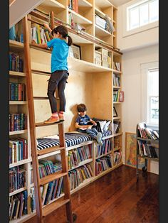 Vertical playroom / library.= this could be built in front of the garge door. No longer a play room? Install a flat screen T.V. in the center cubby. Awesome!
