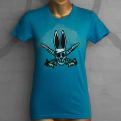 """Our PIWATEY WABBIT done in a hand-painted style on a nice crisp blue Women's T-shirt, slight fade behind the design. From the """"Birdbrain"""" 2009 era.  Women's T-shirt, size SMALL."""