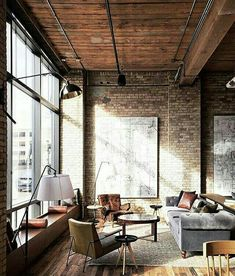 Fantastic window seats, ceiling, and furniture. I adore the light fixtures. A trunk seems like it would fit this space well.