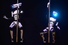 Robots perform a pole dance at a technology show booth occupied by the Tobit Software company, Germany March 9, 2014.
