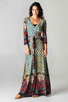 Our Bohemian Maxi Dress is a total showstopper with its array of exotic patterns! Our best-selling wrap dress features ¾...