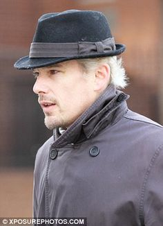 2703353b9a6 Former brunette Ethan Hawke tries to hide his newly bleached hair under a  hat
