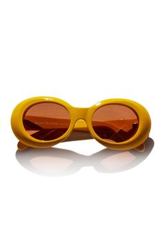 dc603ac6a95 Go mellow yellow in these retro frames from Acne. Oval Sunglasses