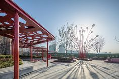 Pomegranate Inspired Community Social Plaza by ASPECT Studios #landscapearchitecture #plaza #china #hefei #sales #center #red #shade #art #sculpture