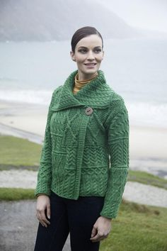 It has a single button at the top and a flowing neck for warmth! The sweater looks great with jeans, dresses or skirts! Wear it for every occasion! The Aran cardigan is crafted from 100% merino wool for warmth and durability! It will certainly keep it shape over the years. This cozy sweater is made by Carraig Donn located in County Mayo, Ireland