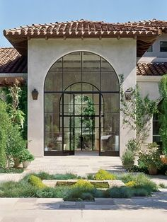 spanish roof, the windows I want and love rounded doors......