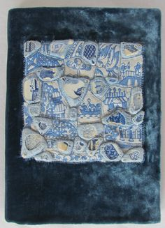 This is my final project for the Creative Embroidery Course at the National College of Art and Design Dublin. Sold to a colleague from the course. Materials used: Blue Willow pattern sea pottery fragments picked up on the Dublin Bay beaches, Blue Willow pattern recycled table cloth, velvet (from a recycled dress), embroidery thread, white card, Delft style patterned cloth