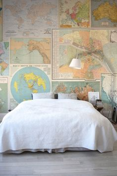 A stunning collage of vintage maps adds so much character to this bedroom.