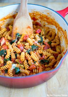 An easy recipe for one pot pasta using rotini pasta, spinach, tomatoes, onion and mozzarella cheese tossed in a tomato basil pasta sauce.