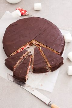 This Giant Homemade Wagon Wheel Biscuit is just like the wagon wheels you grew up with but bigger. A delicious combination of biscuit, marshmallow and raspberry jam all smothered in darkchocolate.