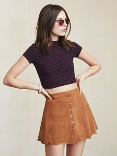 The Inga Top is a turtleneck minus a bit. You know, it's like a sexy math problem, subtract some sleeve, take away a little neck, crop up the length. It all equals something pretty cute. https://www.thereformation.com/products/inga-top-rosmini?utm_source=pinterest&utm_medium=organic&utm_campaign=PinterestOwnedPins