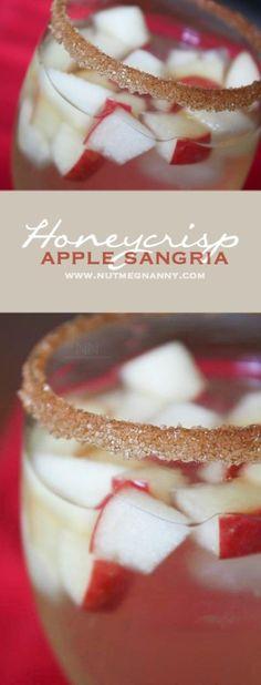 A sweet fall honeycrisp apple sangria that combines fresh picked apples, honey, cinnamon and white wine. A beautiful cinnamon sugar rim tops it off.