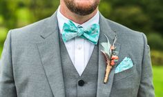 Groom in three piece light grey suit with aqua bow tie & pocket square - Lisa Carpenter - Honour By Alan Hannah For A Rustic Marquee Wedding At Axnoller Dorset With Bridesmaids In Mint Green Ted Baker Dresses And Groom In Paul Smith With Images By Lisa Carpenter Photography