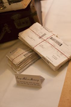 Plane tickets wrapped up like love letters- Long Distance Wedding