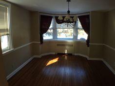 Dining Room with Bay Window, Chair Rail and Hardwood Floors!