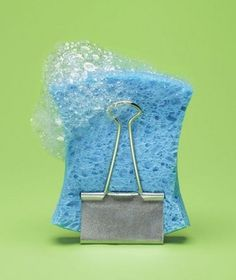 A binder clip creates an easy stand for sponges to air dry.