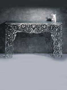 We provide a Designer Limited Edition Stainless Steel Console Table Bookcase, here at Juliette's Interiors - Leading retailers of quality Luxury Furniture. Patterned Furniture, Metal Furniture, Unique Furniture, Luxury Furniture, Stainless Steel Furniture, Gravure Laser, Laser Art, Laser Cut Metal, Cnc Plasma