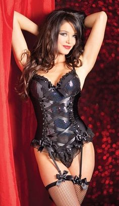 Black latex and lace lingerie with fishnet stockings. Perfect outfit for a hot boudoir session