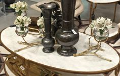 Marble top gold coffee table with gorgeous accessories by Global Views