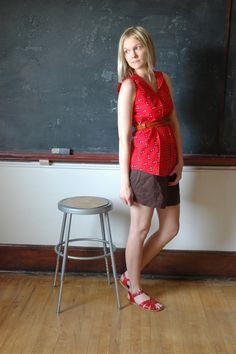 Neutral short, belted long sleeveless top, sandals that pop