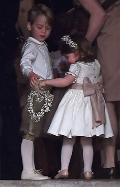 Prince George and Princess Charlotte serve as a page boy and a bridesmaid, respectively, at the wedding of their aunt Pippa Middleton.