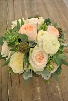 White and pink bridal bouquet with garden roses, ranunculus, seeded eucalyptus, dusty miller, brunia and succulent. Designed by Forget-Me-Not Flowers
