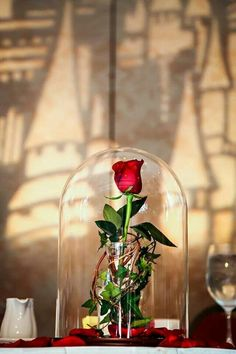 Pretty table decor with a single red rose. Charming and simple to make with the rose color of your choosing.