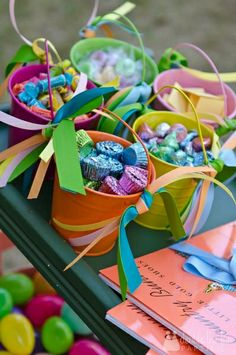 Good gifts for teachers. Just take coloured tin pails and fill them with candy. Add ribbons or even vinyl stickers to the sides and your set.