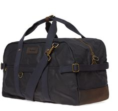 The Barbour Gamefair Holdall is crafted in durable waxed cotton with a rich leather trim. It offers an adjustable width for maximum versatility, and features three external pockets, a zipped inner pocket and a detachable shoulder strap. Spacious and versatile, the Gamefair Holdall has the perfect size for overnight stays, this essential bag features two strong carry handles and a detachable webbing shoulder strap. Antique brass fittings and a cotton lining in Barbour's Classic Tartan.