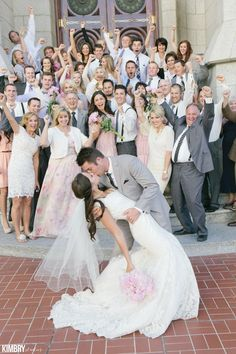 This is the most fun wedding kiss photo ever!