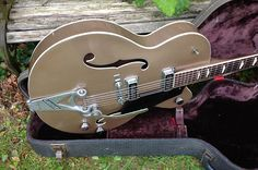 Rare original factory equipped double Dearmond Dynasonic pickup streamliner in uber cool jaguar Tan finish.1960's Gretsch Bigsby tailpiece has been added along the way with a aluminium Bigsby bridge..The Streamliner shared its construction detail with its bigger brother the 6120 with minor cosmet...