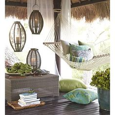 Love this entire outdoor Balinese space - planters, table, lanterns, hammock and decking