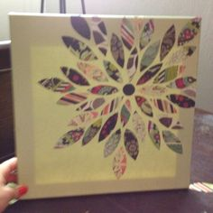 Paint a canvas, cut leaves out of scrapbook paper, use modge podge to glue them down.