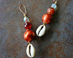 Large Hoop Earrings, Chained Hoop Cowrie Shell Earrings, Ethnic jewelry, Urban Chic Earrings Warning: You have to be bold, charismatic, trendy, colorful, brave, beautiful, encouraged, cultural, spiritual and unique in order to wear adornments such as these. Khepera Adornments, LLC epitomizes cultural essence, specializing in large bold jewelry. Attending a party? These earrings are perfect. A glistening gold plated chained style-hoop with dangling wire-wrapped cowrie shells. Guaranteed to…
