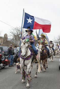 """Jessi Lauppe, riding """"Ironhead,"""" carries the Texas flag in the 2014 Mardi Gras parade in the town of Bandera, the """"Cowboy Capital of Texas."""" Photo, February 22, 2014 by Carol M. Highsmith. The Lyda Hill Texas Collection of Photographs in Carol M. Highsmith's America, Library of Congress Prints and Photographs Division."""