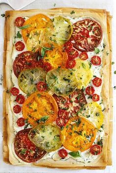 An easy, fresh and flavorful tomato ricotta phyllo tart with flaky pastry layers and chopped herbs. An easy, fresh and flavorful tomato ricotta phyllo tart with flaky pastry layers, chopped herbs, fresh heirloom tomatoes and a ricotta spread. Veggie Recipes, Appetizer Recipes, Vegetarian Recipes, Cooking Recipes, Healthy Recipes, Dishes Recipes, Phyllo Appetizers, Savoury Tart Recipes, French Appetizers