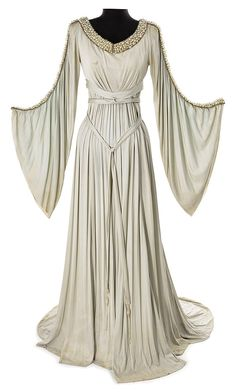 Grey crepe period dress from an unidentified MGM production purchased at the 1970 MGM auction. Grey crepe period dress with flowing sleeves adorned with faux pearls Medieval Dress, Medieval Clothing, Historical Clothing, Medieval Fantasy, Vintage Dresses, Vintage Outfits, Vintage Fashion, Look Gatsby, Fantasy Dress
