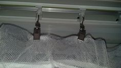 Curtain clips from ikea ($2.99 for 24pk.) turns ugly vertical blinds into curtains!