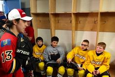 Flames rookie Johnny Gaudreau was the biggest kid on the ice Friday. 'Johnny Hockey' walked into a dressing room full of surprised atom players at a Calgary minor hockey practice, then gave them some free Bauer sticks and a little on-ice instruction. Johnny Gaudreau, Hockey News, Hockey Players, Calgary, Big Kids, Athletes, Sports, Hs Sports, Sport