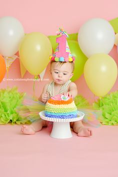 Blog | 11 Sixteen Photography, pink and rainbow cake smash, rainbow cake, first birthday, birthday hat, one, balloons, pink backdrop, pearls
