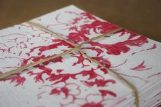 This is beautiful: recycled watercolor paper invitations backed with Cabbages and Roses Cerise Hately fabric