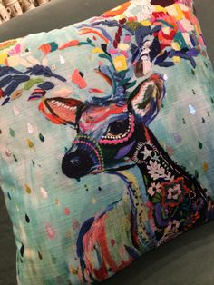 Cuddly Christmas!  This reindeer pillow is a work of art! The colors are fab too #anthroregistry