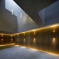 Chinese studio Neri&Hu has used smooth grey stone and fluted bronze to revive the grandeur of a 1930s theatre in Shanghai