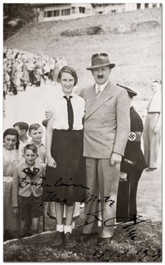 Adolf Hitler poses with a female youth in 1939.